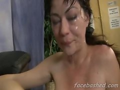 Brunette whores face destroyed with a cock as she chokes and gags