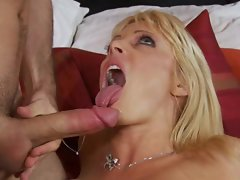 Holly Sampson receives a fresh pile of cream pie on her lips