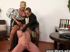 Domina guides useless man on a fuck