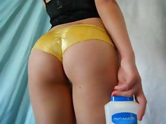 Lotion on golden ass