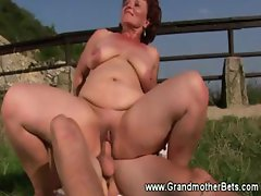 Horny granny loves to fuck outdoors