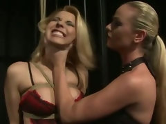 Blonde dominatrix massaging her peon breasts and ass