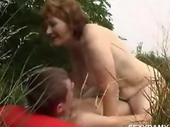 Mature woman and young boy 3