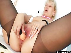 Blond milf in latex uniform extreme dildoing