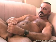Mature bear jerking off his hard cock