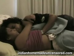 Desi couple making love in the bed.