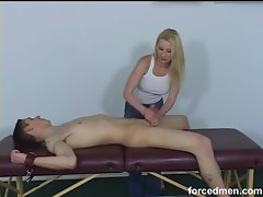 Bound dude gets a rough handjob