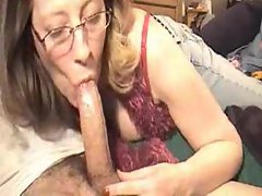 Deepthroating mature in glasses