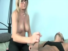 Milf in spex tugs cock for this very lucky guy