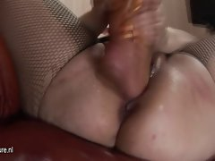 Kinky big titted mama gets foot fisted