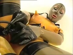 Girl in rubber masturbates