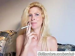 Nice looking blondie Mommy find enjoyment in a smoke break